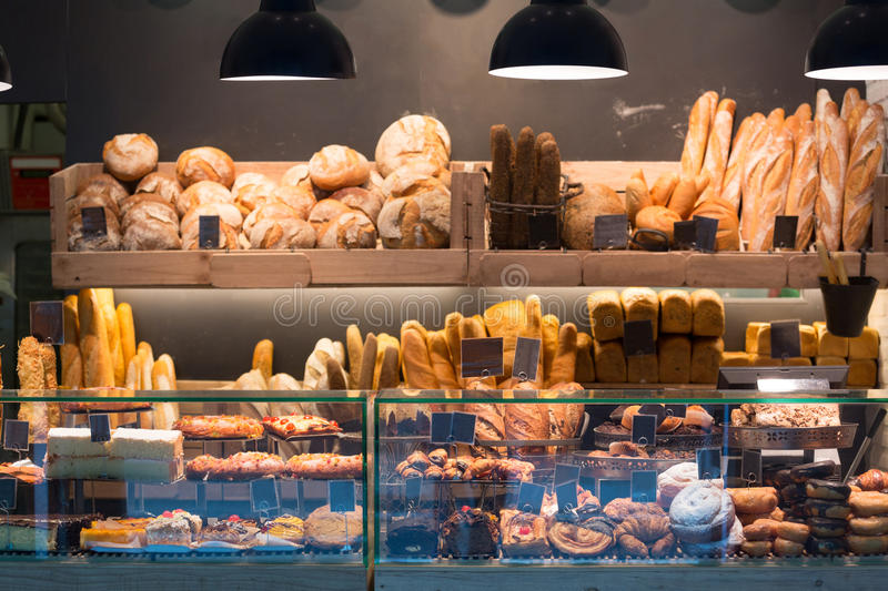 Modern bakery with assortment of bread. Cakes and buns stock image