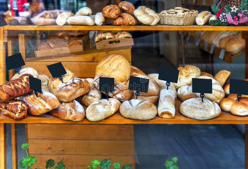 Modern bakery with assortment of different bread royalty free stock photos