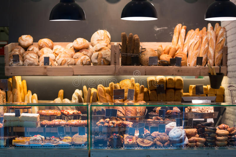 Modern bakery with different kinds of bread. Cakes and buns royalty free stock photography