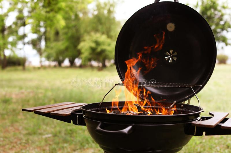 Modern barbecue grill with fire flames. Outdoors royalty free stock photos