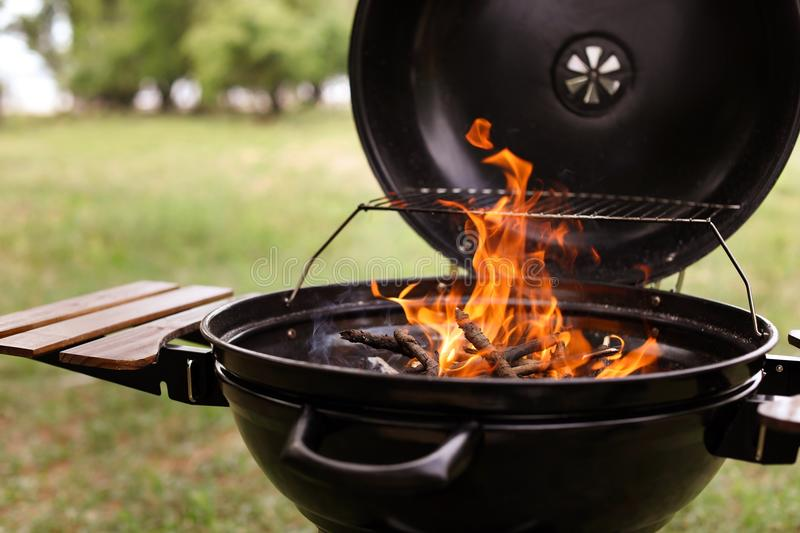 Modern barbecue grill. With fire flames outdoors stock images