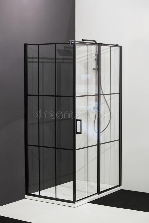 Modern bath room interior, black grid shower. Loft partition black cage with glass. Minimalistic modern shower royalty free stock photo