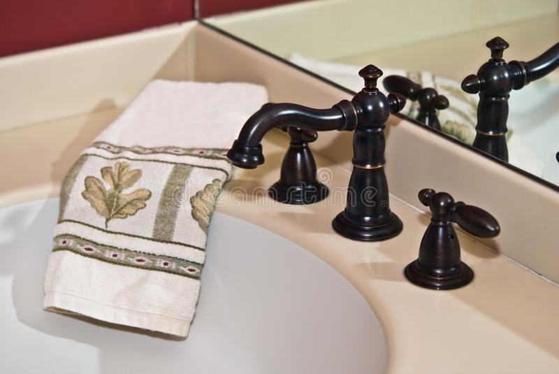 Modern Bath Sink/Faucet /Towel royalty free stock photography