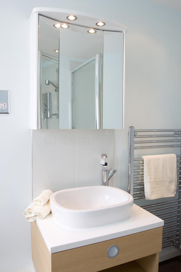 Modern bathroom. A contemporary designer bathroom in a new property development royalty free stock image