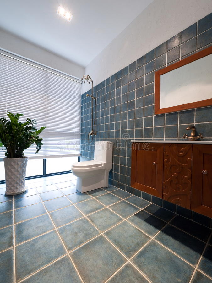 Modern bathroom. With wooden cabinet,mirror and plant stock photo