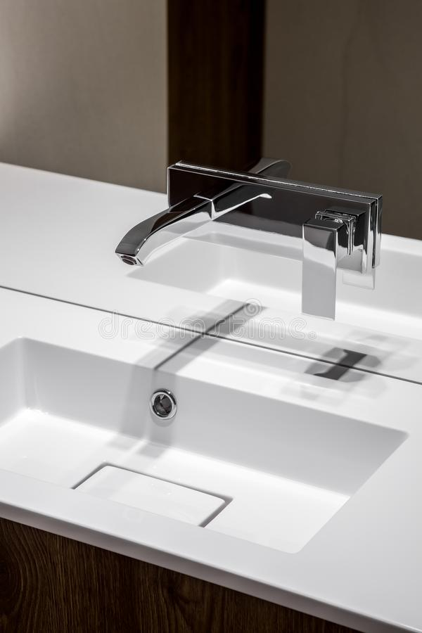 Modern bathroom basin with faucet stock images