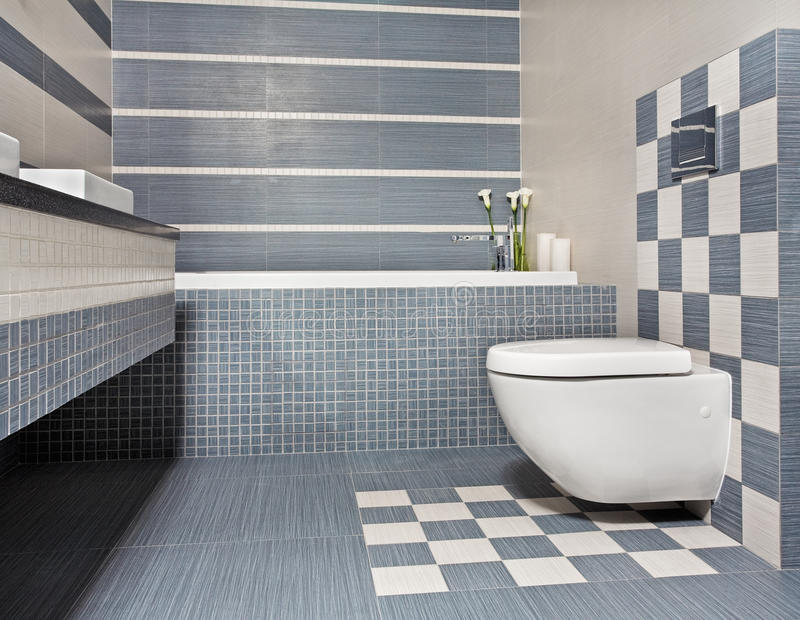Modern bathroom in blue and gray tones with toilet stock for Moderne wandfliesen