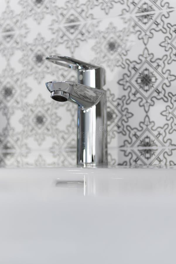Modern bathroom chrome faucet royalty free stock photo