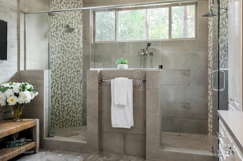 Modern bathroom design, large shower, home interiors royalty free stock photography