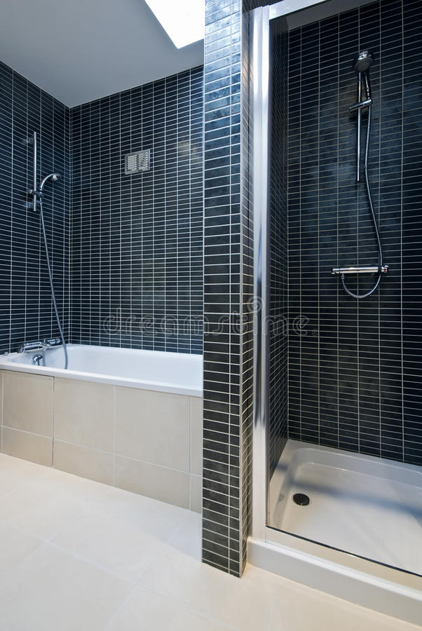 Modern bathroom detail with bath tub and shower stock for Detail in contemporary bathroom design