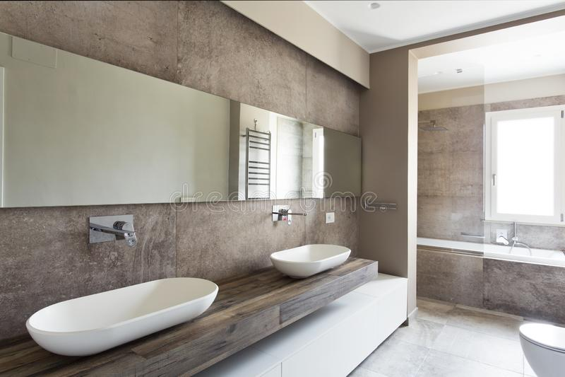 Modern bathroom with double sink royalty free stock image