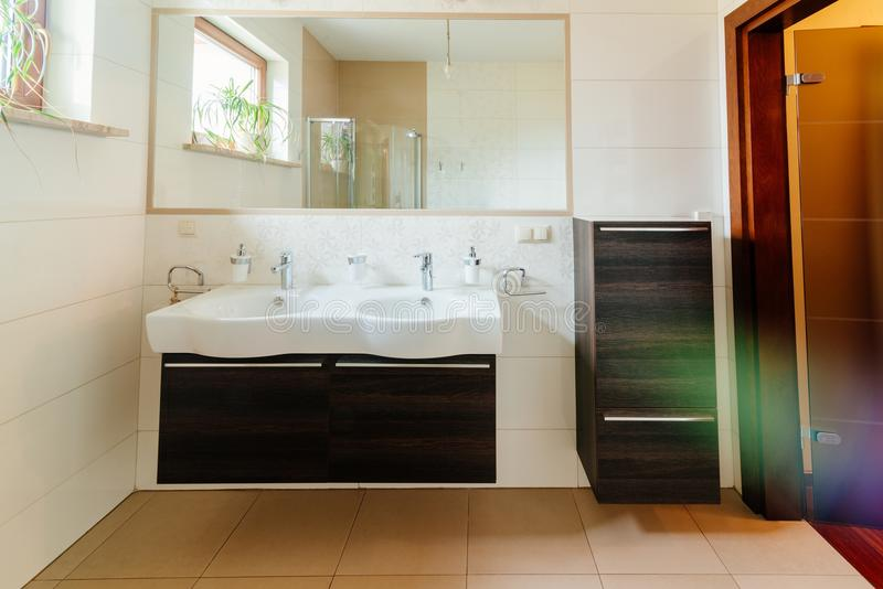 Modern bathroom with double washbasin. And mirror royalty free stock photos
