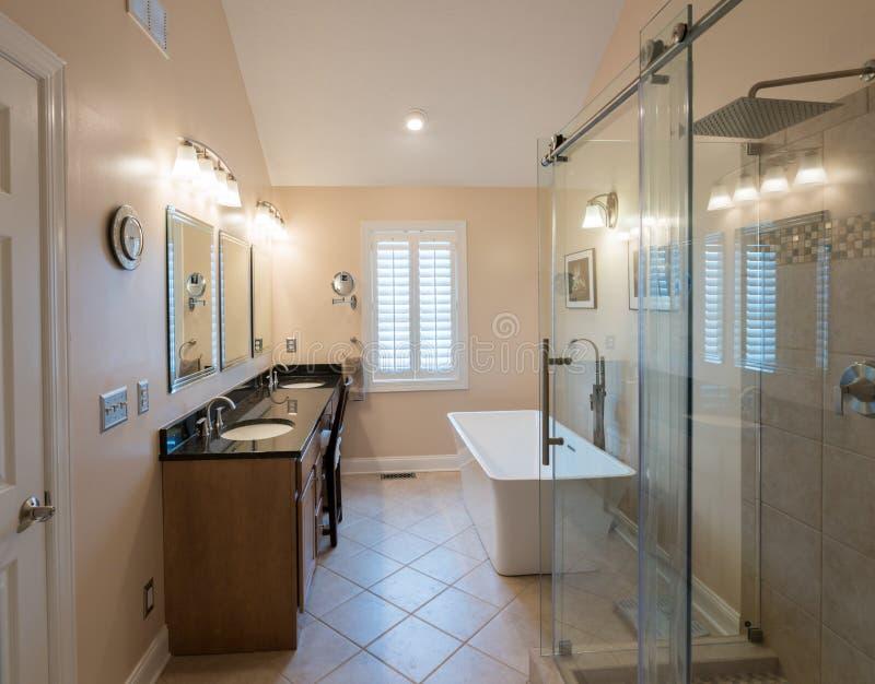 Modern Bathroom With Freestanding Tub And Vanity Stock Photo - Image ...
