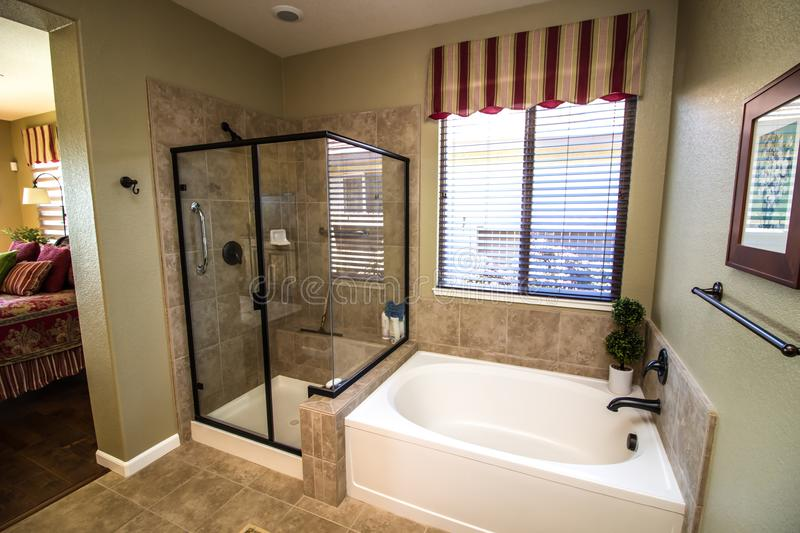 Modern Bathroom With Glass Shower And Tub royalty free stock photography