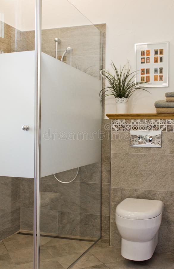 Modern bathroom interior with shower and toilet stock photo