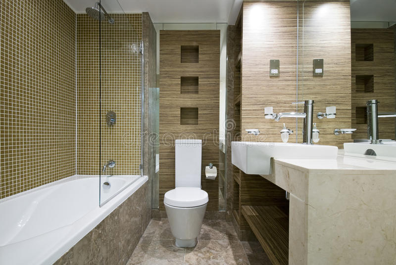 Modern bathroom with marble floor and mosaic tiles stock photos