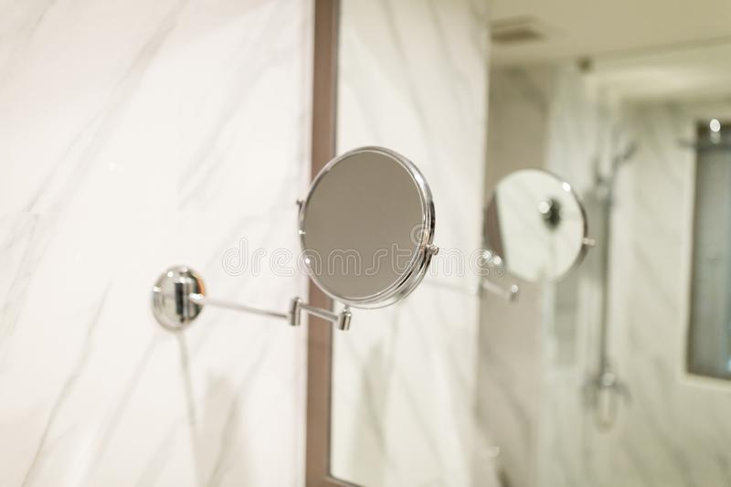 Modern bathroom in the resort hotel. small and big mirrors, marble wall. Modern bathroom in the resort hotel. small and big mirrors stock photography