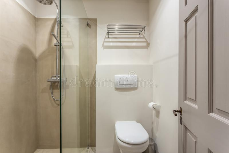 Modern bathroom shower room with toilet and amenities. Modern bathroom shower room with toilet and amenities royalty free stock photos