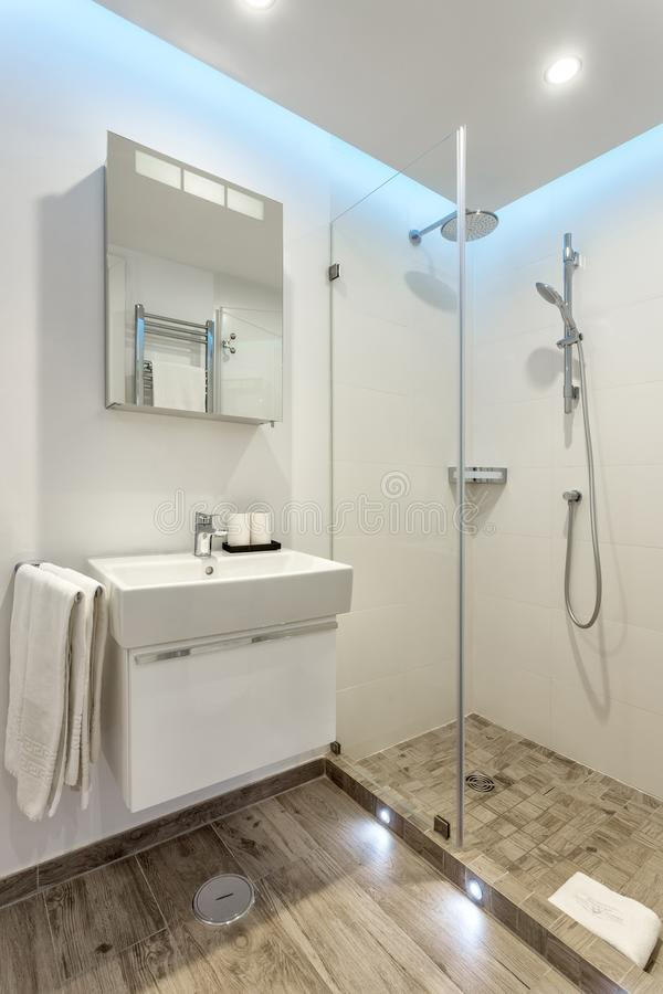 Modern bathroom shower room with toilet and amenities. Modern bathroom shower room with toilet and amenities royalty free stock photo