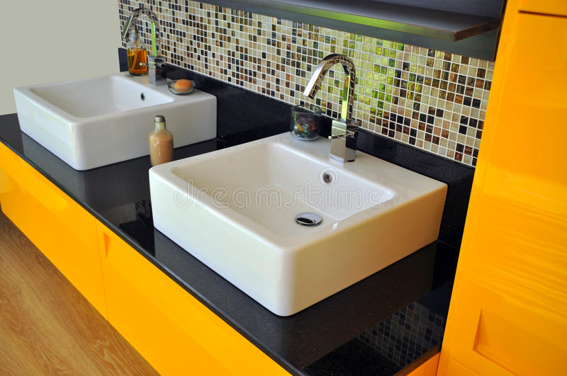 Modern bathroom sink. Detail from a modern and contemporary bathroom royalty free stock photos