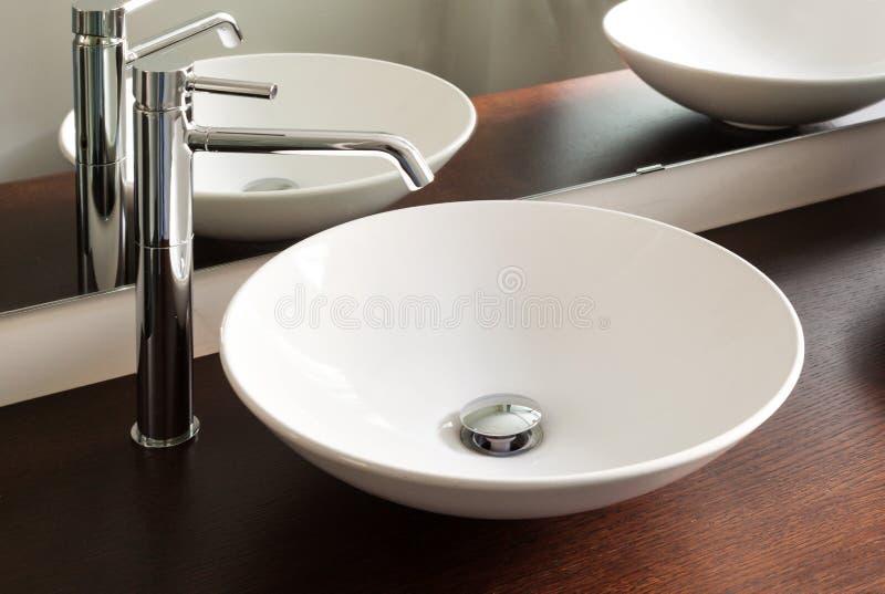 Modern bathroom, sink stock photography