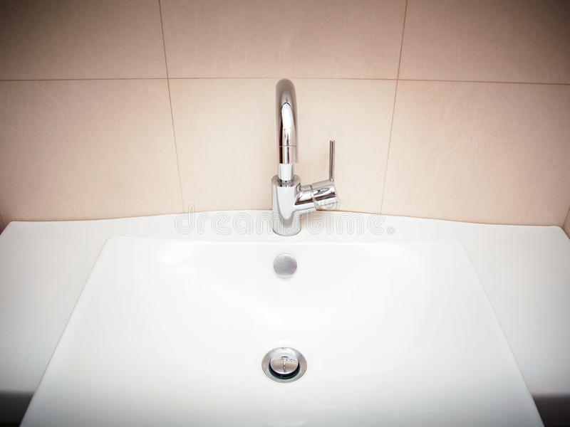 Modern bathroom sink in white ceramic royalty free stock images