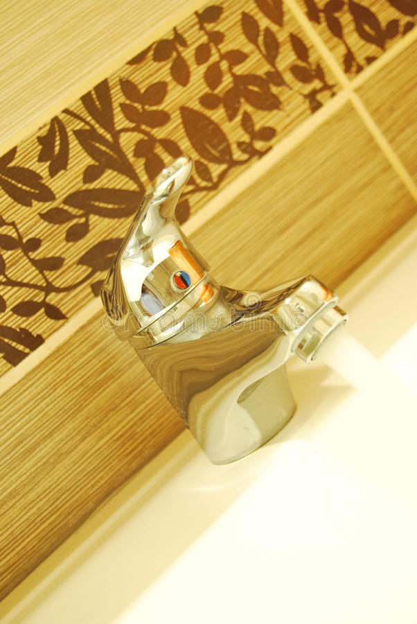 Modern Bathroom Taps. A modern basin mixer tap in a contemporary bathroom royalty free stock image