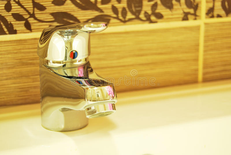 Modern Bathroom Taps. A modern basin mixer tap in a contemporary bathroom stock images