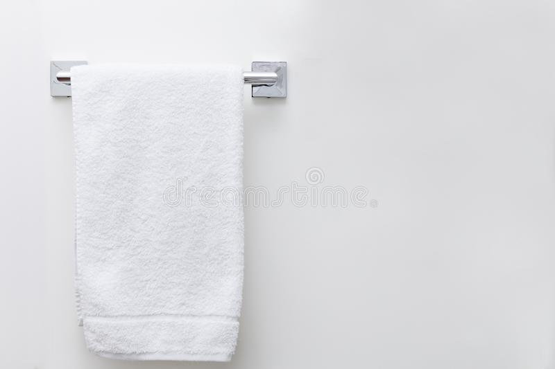 Modern bathroom towel dryer on white wall background with copy space royalty free stock photo