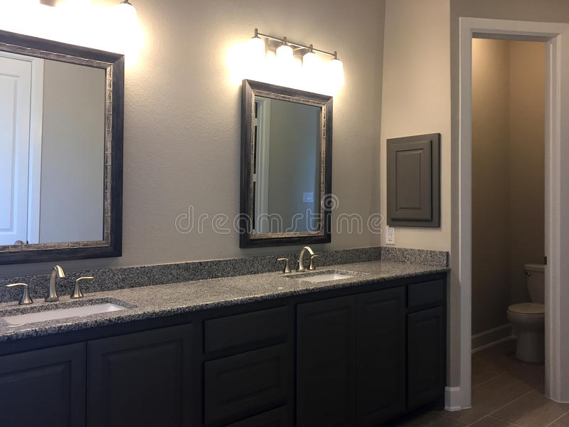 Modern bathroom with two mirror in a new house. Nice bathroom with two mirrors in a new house, TX USA stock image