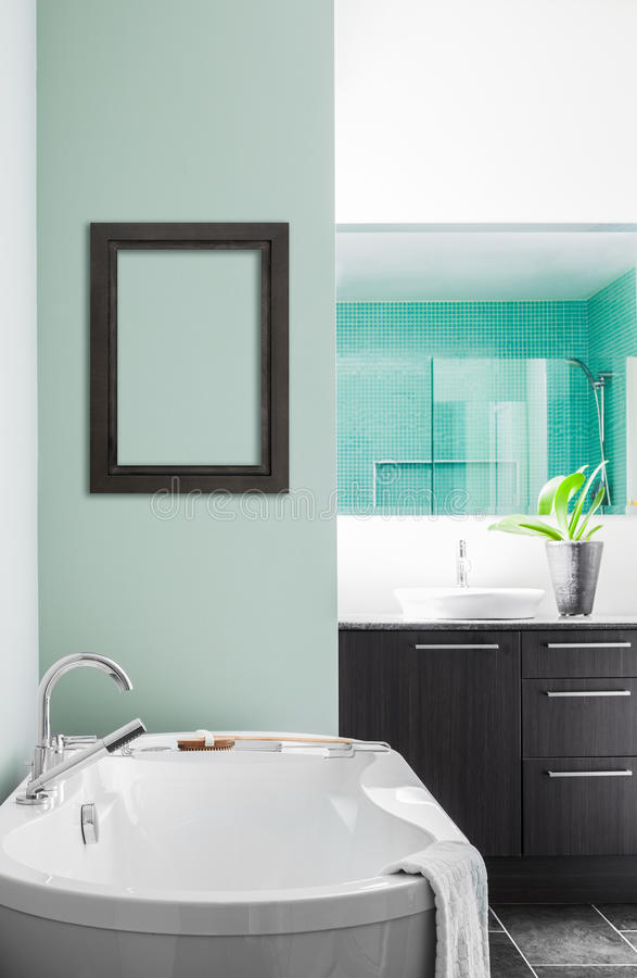 Modern Bathroom using soft Green Pastel Colors. Modern Bathroom with blank wall for your test, image or logo. Soft Green Pastel Colors royalty free stock photos