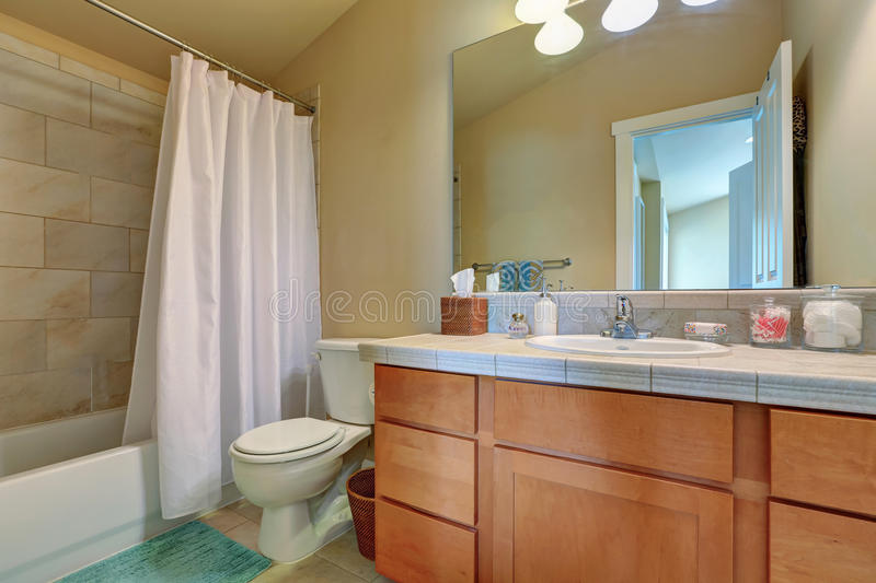 Modern bathroom vanity cabinet with drawers and marble top stock image