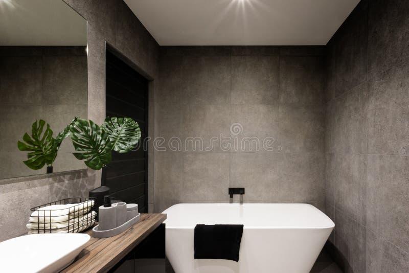 Modern bathroom wall made in dark color tiles stock photos