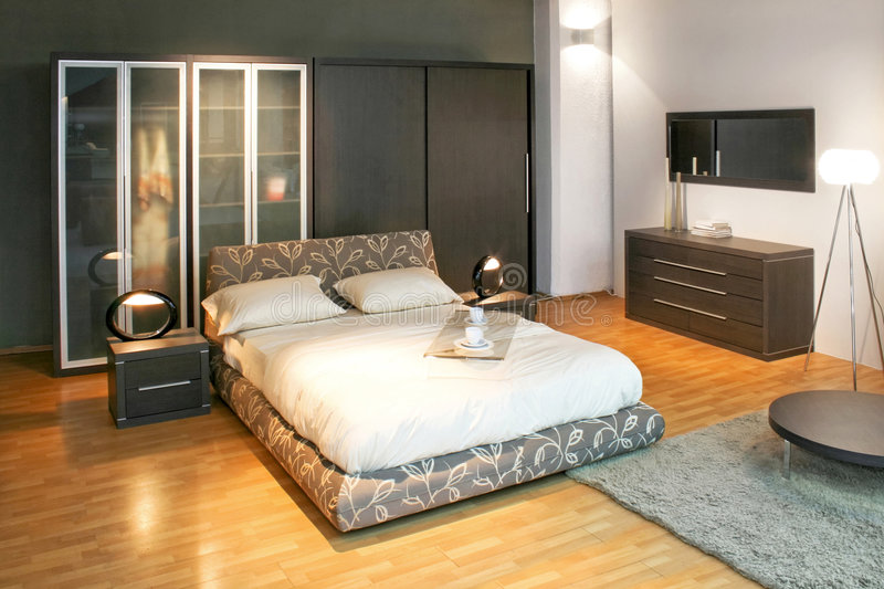 Modern bedroom angle. Modern double bed and big wardrobe closet stock images