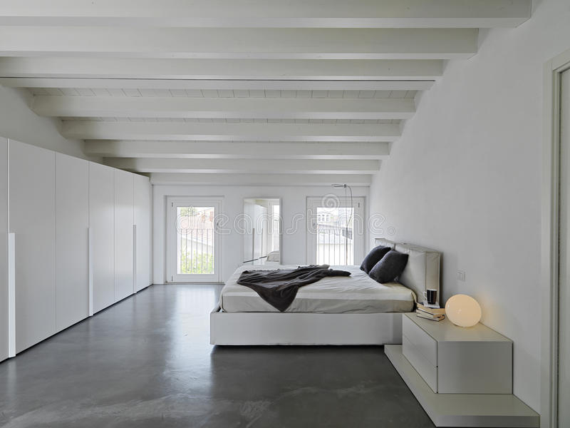 Modern bedroom in the attic rooms royalty free stock image