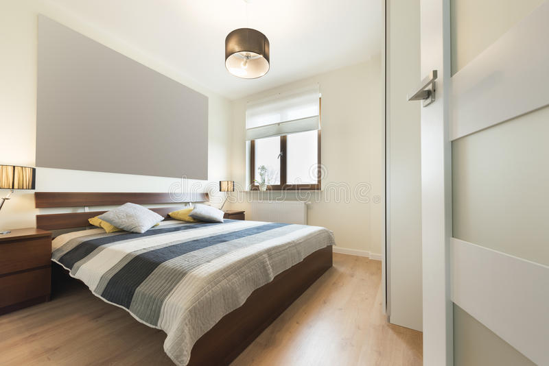 Modern bedroom in beige finishing royalty free stock photography