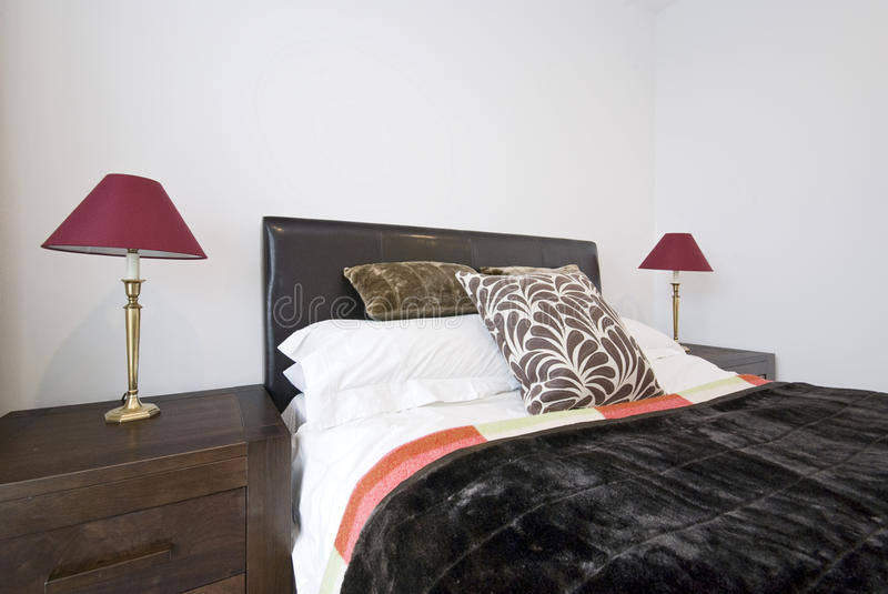 Modern bedroom with double bed stock photo