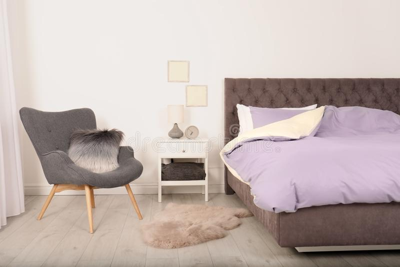 Modern bedroom interior with comfortable armchair. Stylish design royalty free stock images