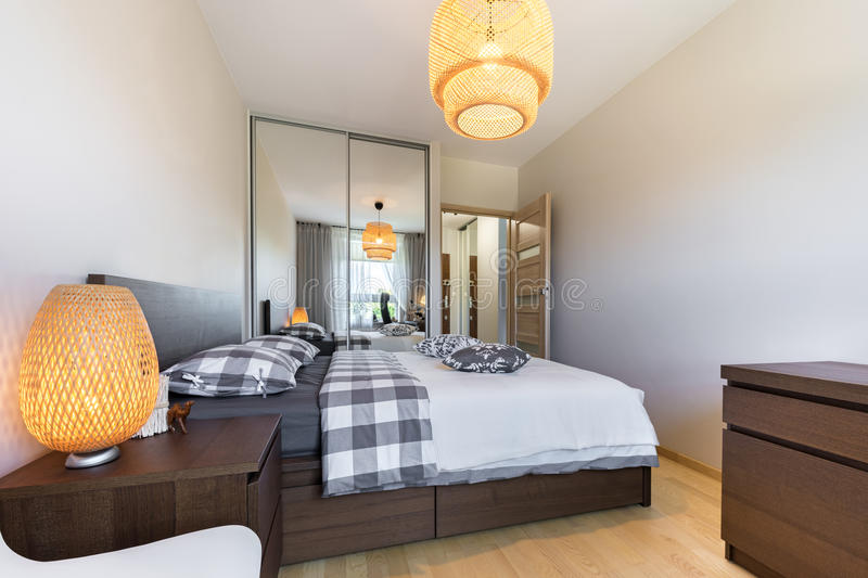 Modern bedroom interior design. In wooden finish royalty free stock images