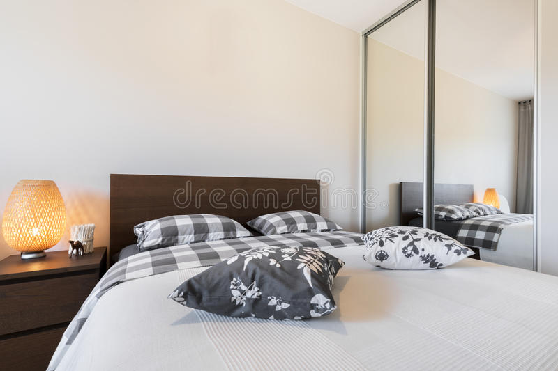 Modern bedroom interior design. In wooden finish royalty free stock image