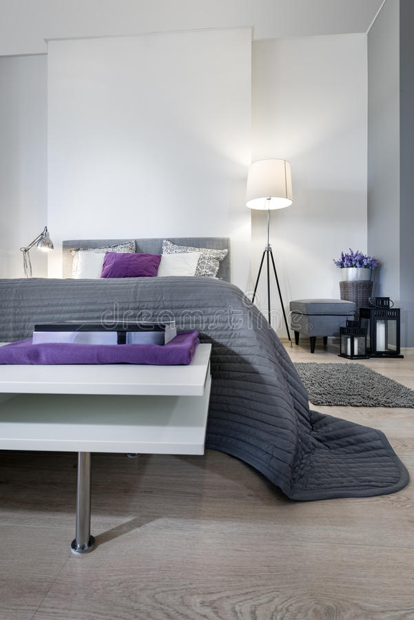 Modern bedroom interior design. With violet pillow royalty free stock image
