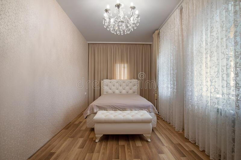 Modern bedroom in luxury apartment stock photography
