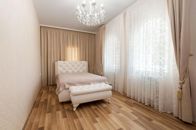 Modern bedroom in luxury apartment royalty free stock photos