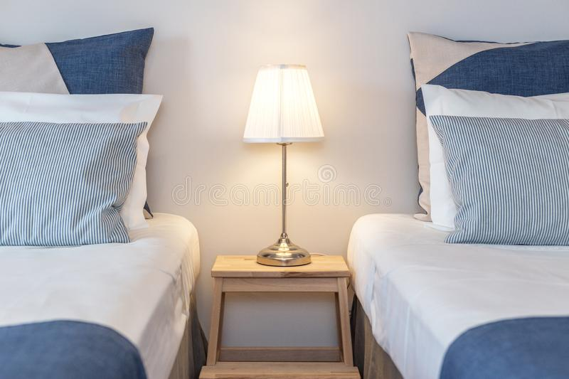 Modern bedroom with pillows and a bed for tourists. Frontally. Modern bedroom with pillows and a bed for tourists. Frontally stock photography