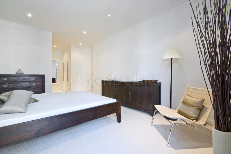 Modern bedroom with wooden furniture stock photo