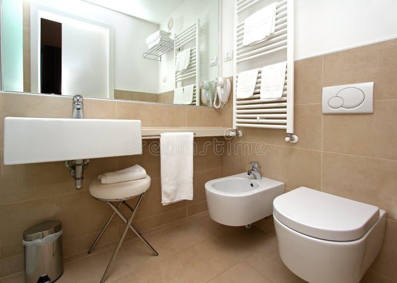 Modern beige bathroom stock photography