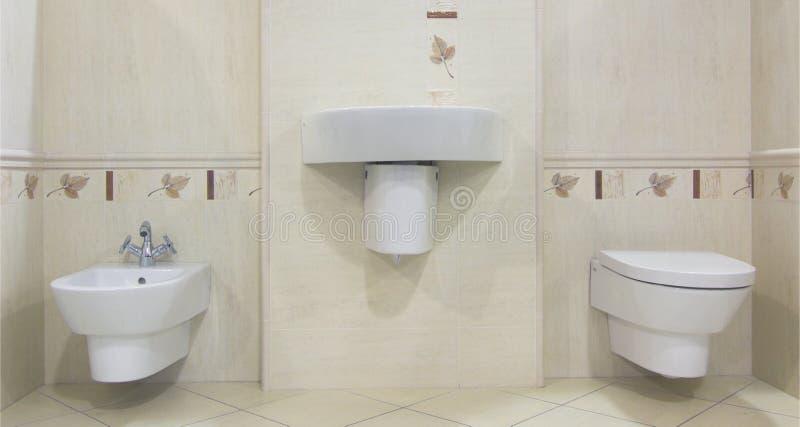 Modern beige bathroom. With sink, toilette and bidet stock photos