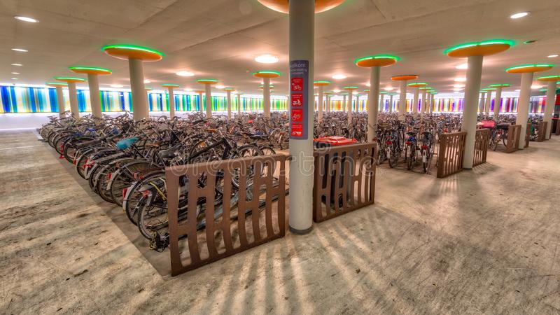 Modern bicycle parking at train station royalty free stock photography