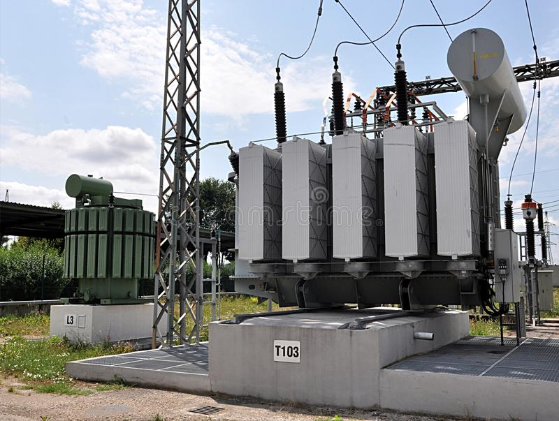 Big oil transformers. Modern big oil transformers in day stock photography