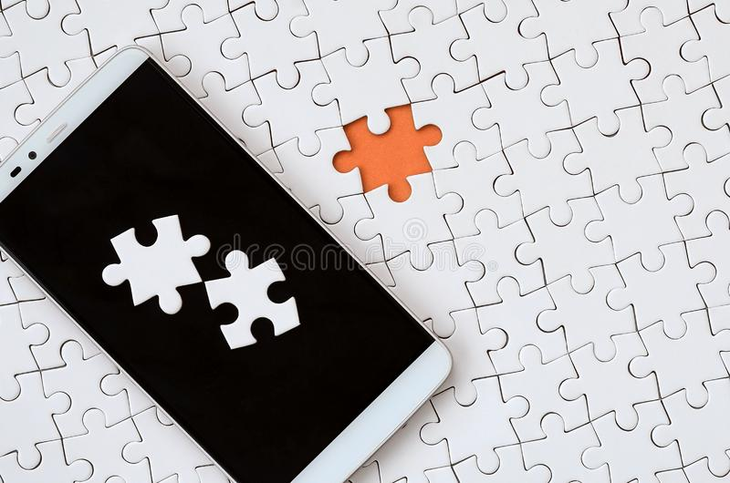 A modern big smartphone with several puzzle elements on the touch screen lies on a white jigsaw puzzle in an assembled state with. Missing elements vector illustration